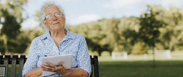An old lady with notebook