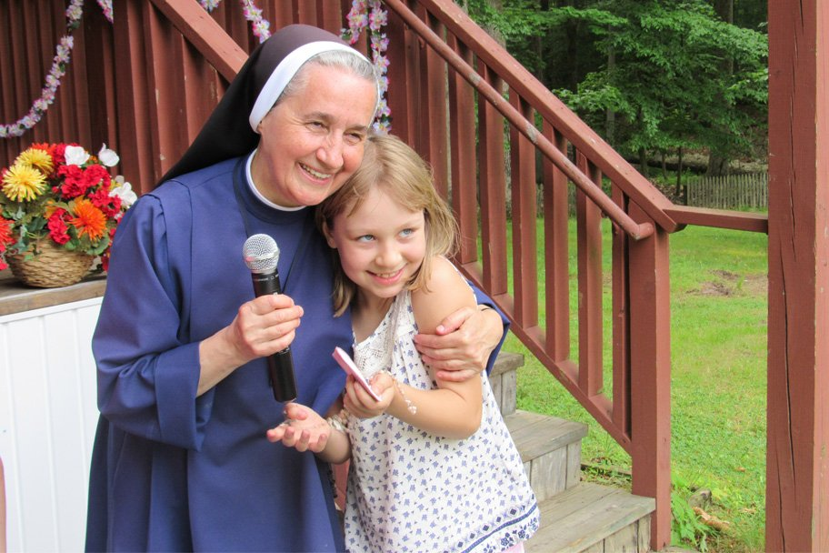 St. Joseph's sister with a girl